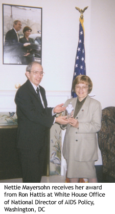 Nettie Mayersohn receives her award from Ron Hattis at White House Office of National Director of AIDS Policy, Washington, DC