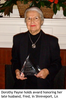 Dorothy Payne holds award honoring her late husband, Fred, in Shreveport, LA